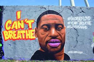ein grafiti eines schwarzen mannes. daneben der schriftzug: i can´t breathe.