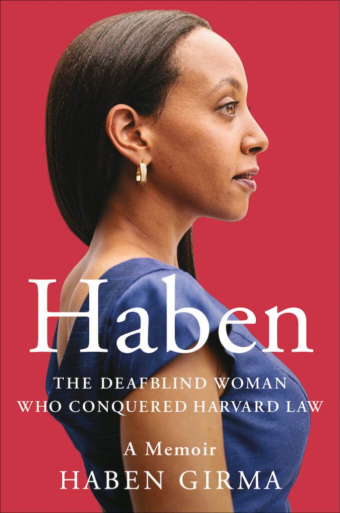 """Ein Buch-Cover. Eine Frau mit schwarzen, kinn.langen Haaren steht im Profil. Sie trägt eine blaue Bluse. Der Hintergrund ist rot. Auf dem Titel des Buches steht groß """"Haben"""". Darunter: The deafblind woman who conquered haverd law."""